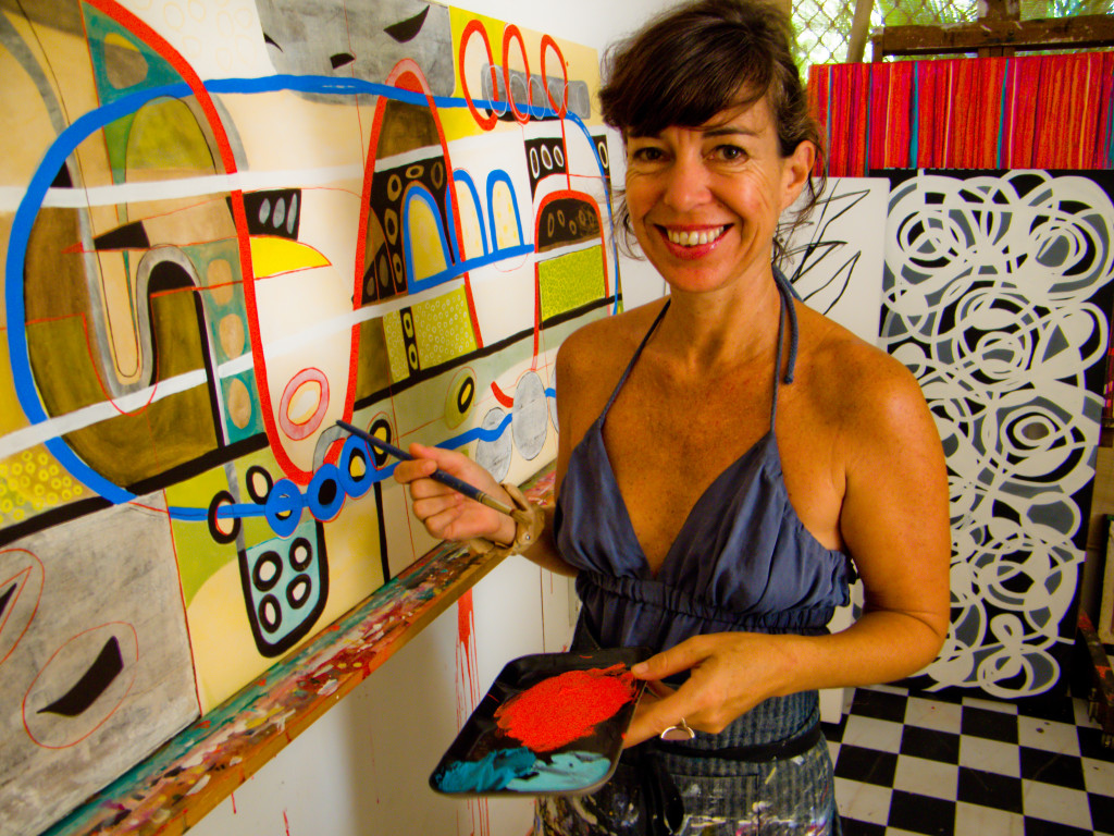 Nina painting 'From Seed' in her old Darwin studio (2009)